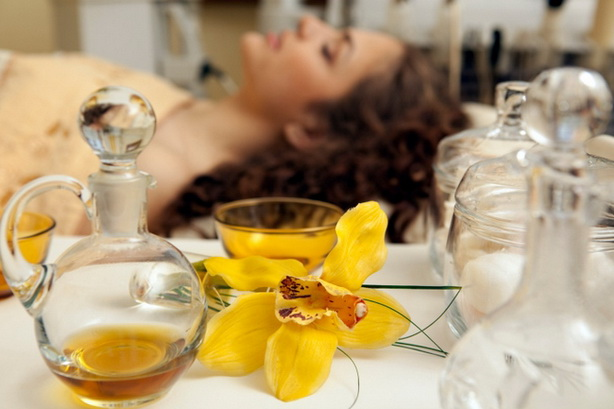 Beauty treatment: different oil bottles and orchid.